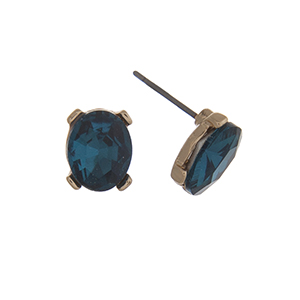 "Gold tone post style earrings displaying an oval aqua rhinestone. Approximately 3/8"" in length."