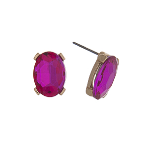 "Gold tone post style earrings displaying an oval fuchsia rhinestone. Approximately 1/2"" in length."