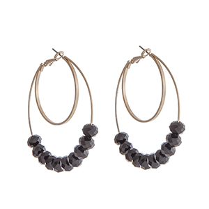 "Gold tone layered hoop earrings with black faceted beads. Approximately 2"" in length."