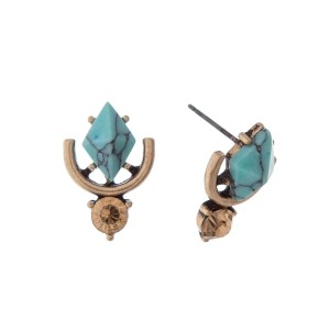 "Burnished gold tone stud earrings with a turquoise stone and a champagne rhinestone. Approximately 3/4"" in length."
