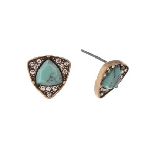 "Gold tone stud earrings with a triangle turquoise stone surrounded by clear rhinestones. Approximately 1/2"" in length."