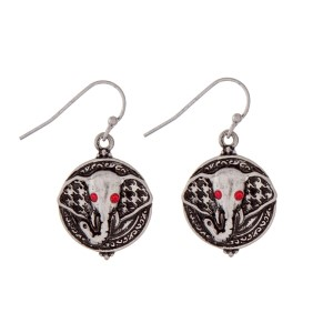 "Silver tone fishhook earrings with an elephants head and red rhinestones. Approximately 3/4"" in length."