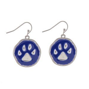 "Silver tone fishhook earrings featuring an epoxy royal blue paw print. Approximately 1"" in length."