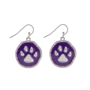 "Silver tone fishhook earrings featuring an epoxy purple paw print. Approximately 1"" in length."