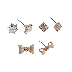 Gold tone three pair earring set with clear rhinestone studs, iridescent square studs, and gold tone bow studs.