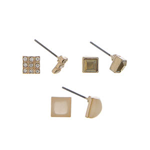 Gold tone three pair stud earring set with beige stones.