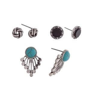 Burnished silver tone three pair earring set with knot studs, black stone studs and turquoise studs.