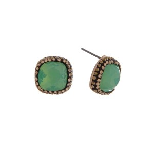"Gold tone stud earrings with a mint green stone surrounded by topaz rhinestones. Approximately 1/2"" in length."