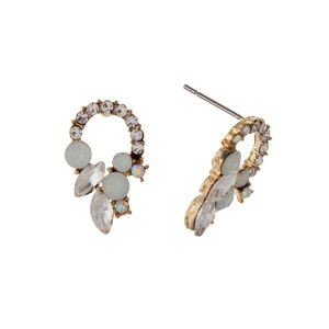 "Gold tone stud earrings with clear and white opal rhinestones. Approximately 1/2"" in length."
