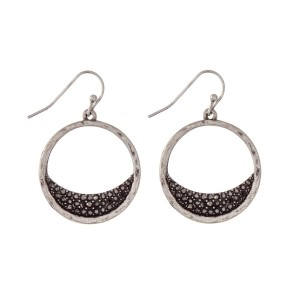 "Burnished silver tone fishhook earrings with hematite rhinestones. Approximately 1"" in length."