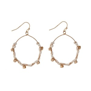 "Gold tone fishhook earrings wrapped in ivory suede with gold tone bead accents. Approximately 1.5"" in length."
