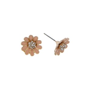 "Dainty gold tone stud earrings featuring a peach flower accented with clear rhinestones. Approximately 1/2"" in length."