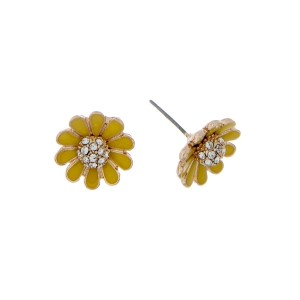 "Dainty gold tone stud earrings featuring a yellow flower accented with clear rhinestones. Approximately 1/2"" in length."