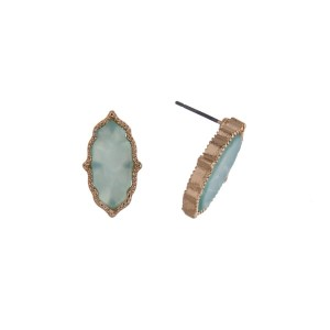 "Gold tone Moroccan shape studs with a mint green pearlized center. Approximately 1/2"" in length."