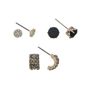 Gold tone three pair earring set with black rhinestone studs.
