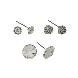 Silver tone three pair earring set with clear rhinestone studs, pave rhinestone studs and faceted clear studs.