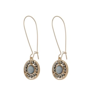 "Gold tone hook earrings featuring a gray beaded circle pendant. Approximately 3"" in length."