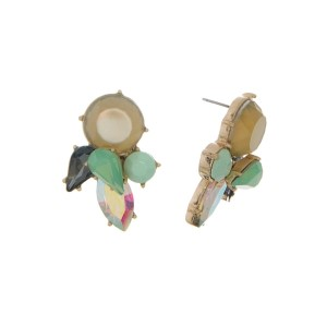 "Gold tone stud earrings with beige and mint green rhinestones. Approximately 1.5"" in length."
