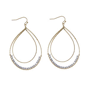 "Gold tone fishhook earrings featuring a hammered curved teardrop with gray wire wrapped beads. Approximately 3"" in length."