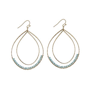 """Gold tone fishhook earrings featuring a hammered curved teardrop with turquoise wire wrapped beads. Approximately 3"""" in length."""