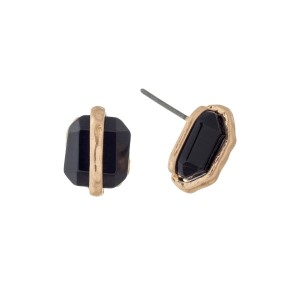 "Dainty gold tone stud earrings with a black stone. Approximately 1/2"" in length."