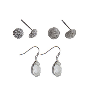 Silver tone three pair earring set with pave rhinestone studs, hammered texture studs and clear rhinestone teardrop fishhooks.
