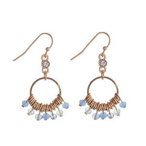 "Gold tone fishhook earrings with blue and white opal beads. Approximately 1"" in length."