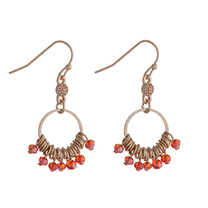 "Gold tone fishhook earrings with red beads. Approximately 1"" in length."