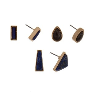 Gold tone three piece earring set with blue, gray, and lapis geometric studs.