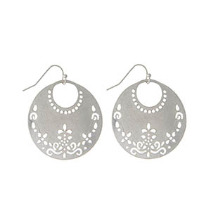 "Silver tone fishhook earrings with a laser cut circle. Approximately 2"" in length."