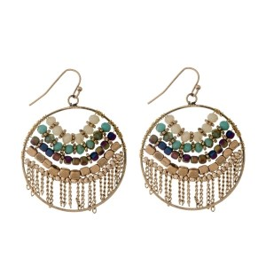 "Gold tone fishhook earrings with turquoise and ivory beads with metal fringe. Approximately 1.5"" in length."
