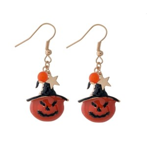 "Gold tone fishhook earrings with pumpkins wearing witch's hats. Approximately 1"" in length."