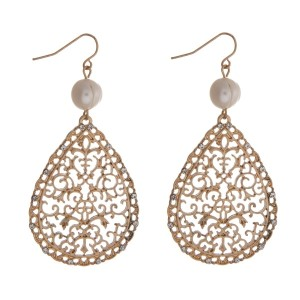 "Gold tone fishhook earrings with a filigree teardrop shape and a freshwater pearl bead. Approximately 3"" in length."