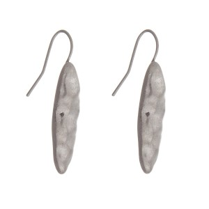 "Hammered silver tone earrings with an oval shape. Approximately 1"" in length."