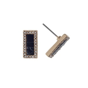 """Dainty gold tone stud earrings with a black stone surrounded by clear rhinestones. Approximately 1/2"""" in length."""