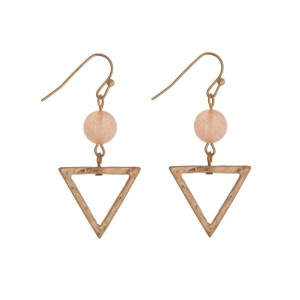"""Gold tone fishhook earrings with a triangle shape and a peach bead. Approximately 1.25"""" in length."""