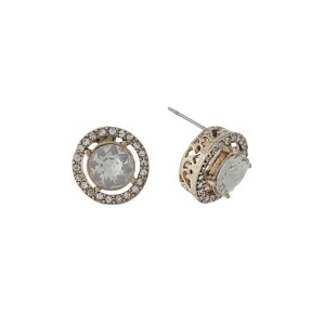 "Gold tone stud earrings with clear rhinestones and a clear center rhinestone. Approximately 1/2"" in length."
