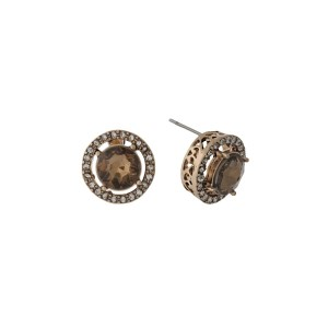 "Gold tone stud earrings with clear rhinestones and a topaz center rhinestone. Approximately 1/2"" in length."