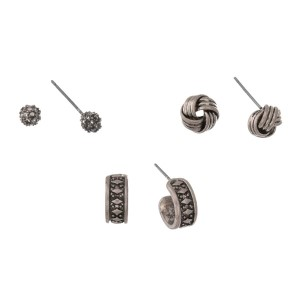 Burnished silver tone three pair earring set with pave circle studs, knot studs, and hoops.