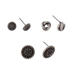 Burnished silver tone three pair earring set with textured circle studs, knot studs and black rhinestone studs.
