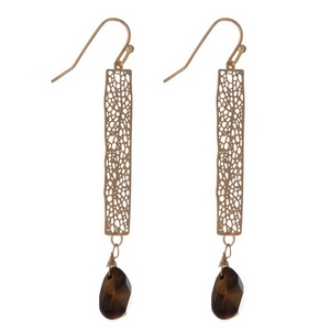 """Gold tone fishhook earrings with a filigree bar and tiger's eye teardrop bead. Approximately 2.5"""" in length."""