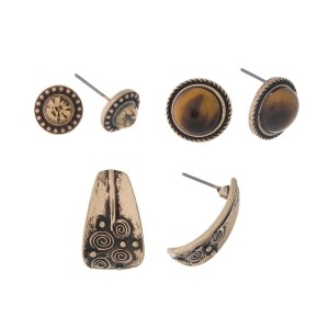 Burnished gold tone three pair earrings with topaz rhinestones, tiger's eye circles, and textured studs.