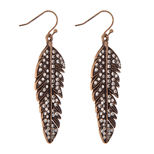"Burnished gold tone feather earrings with clear rhinestone accents. Approximately 1.75"" in length."