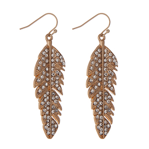 "Gold tone feather earrings with clear rhinestone accents. Approximately 1.75"" in length."