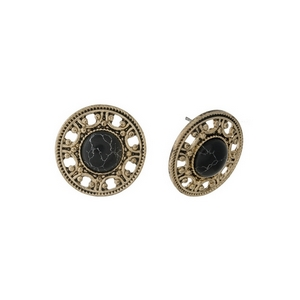 """Burnished gold tone, circle shaped, stud earrings with a black stone. Approximately 1"""" in length."""