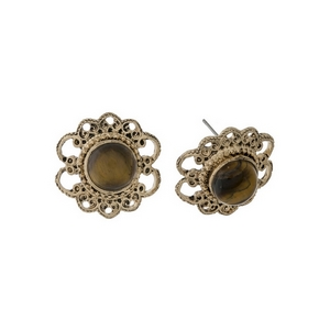 "Burnished gold tone, flower shaped, stud earrings with a brown stone. Approximately 1"" in length."