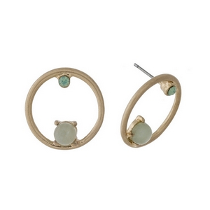 "Gold tone circle stud earrings with green stone and rhinestone accents. Approximately 1"" in length."