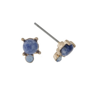 "Dainty gold tone stud earrings with a blue stone accented by an opal rhinestone. Approximately 1/4"" in length."
