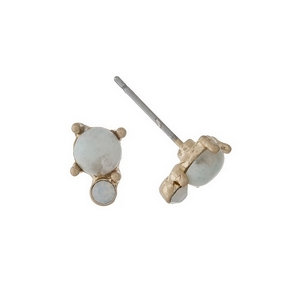 "Dainty gold tone stud earrings with an ivory stone accented by an opal rhinestone. Approximately 1/4"" in length."
