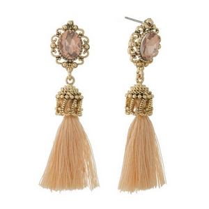 "Gold tone post style earrings with a peach rhinestone and fabric tassel. Approximately 2"" in length."